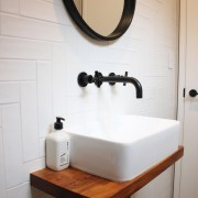 The powder room features a Victoria White Satin