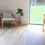 Habita Castagna woodgrain porcelain tiles feature in this