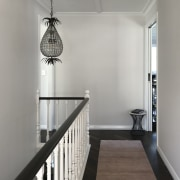 A pineapple pendant in the hallway adds a
