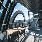 The office building's rounded, layered design results in architecture, building, daylighting, house, interior design, property, real estate, room, black