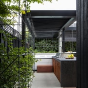 Cages help contain the evergreen plantings when they