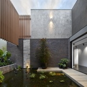A central internal pond brings nature into the