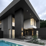 The clean-lined, mosaic-lined pool is more than a