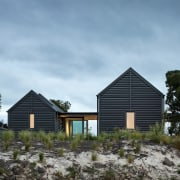 The home is planned as two pavilions linked