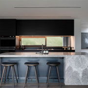 The stone finish on the kitchen island is