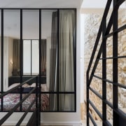 A 3 storey family home in Paris gets architecture, building, ceiling, daylighting, door, floor, furniture, glass, handrail, home, house, interior design, iron, metal, property, real estate, room, stairs, window, gray, black