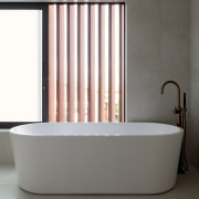 The upstairs master ensuite includes a freestanding bath
