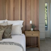 Vertical cedar weatherboards feature on the interior as
