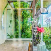 A rain head shower seems appropriate in this architecture, building, ceiling, door, floor, glass, hardwood, home, house, houseplant, interior design, plant, property, real estate, room, window, green