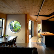 CLT walls allow the structure to create striking brown, black