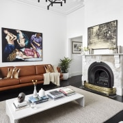 Fireplace in renovated terrace home by architects McMahon furniture, hearth, home, interior design, living room, room, table, white
