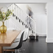 Stairs in renovated terrace home by architects McMahon architecture, black and white, chair, floor, flooring, furniture, home, interior design, table, wall, white