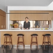 To the ground floor a combined kitchen and cabinetry, countertop, furniture, interior design, kitchen, room, table, gray