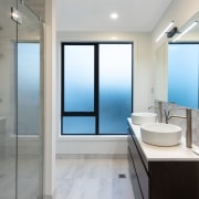 Bathrooms in the show home are contemporary and