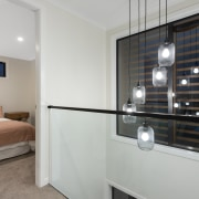 A double height void features outside bedroom 2