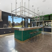 A green brick island finish pops within the