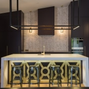 The kitchen needed to have a feel of architecture, building, ceiling, countertop, design, floor, flooring, furniture, home, house, interior design, kitchen, light fixture, lighting, material property, room, tile, black, gray