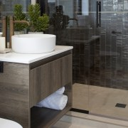 The master vanity features aged brass tapware, a
