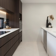 Recessed pulls contribute to the kitchen's pared back