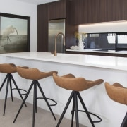 Comfortable designer breakfast stools accompany the bright, clean-lined