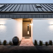 White bagged brick cladding grounds the house to