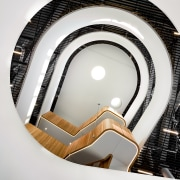 The circulation stair hangs out over the atrium