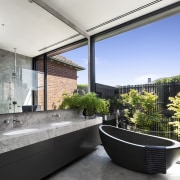 A stone freestanding tub in the master ensuite