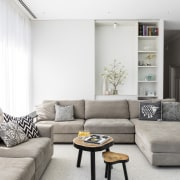 A sliding panel reveals and conceals different storage