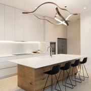 Handleless cabinetry adds to the kitchen's minimalist presence.