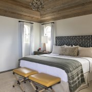 A timber ceiling features in this guest bedroom.