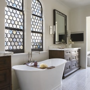 The master bathroom includes a freestanding slipper bath.