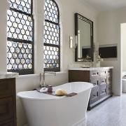 The master bathroom includes a freestanding slipper bath.