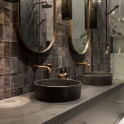 Tall mirrors draw attention the master ensuite's lofty