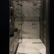 Using the marble look large format tile on