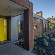 ​​​​​​​Corten steel panel cladding is a feature of black