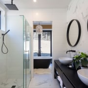 The bathrooms feature marble tiles and matte black