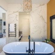 A generous free standing bathtub is a luxurious