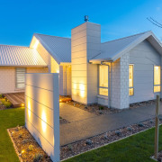 White brick cladding teemed with a pale, steel,