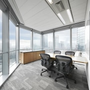 Glass walls on most perimeter offices maximise the