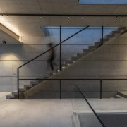 This contemporary home's glass and concrete rooftop pool architecture, building, ceiling, daylighting, floor, flooring, glass, handrail, house, interior design, room, space, stairs, wall, gray, black, concrete staircase
