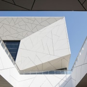 Crackling on the Opera house's facade is reminiscent architecture, ceiling, daylighting, design, line, material property, space, tile, triangle, white