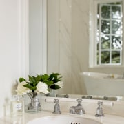 The double vanity has raised on-bench cabinets, classical