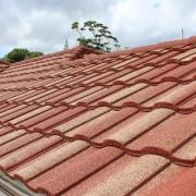 Metrotile Roof 1 - brick | daylighting | brick, daylighting, facade, outdoor structure, roof, sky, wood, red, orange