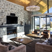 Furnishings were specified to give the extra-large living home, interior design, living room, real estate, gray, black
