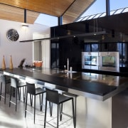 High-gloss, black-lacquered Arclinea cabinets are teamed with a countertop, furniture, interior design, kitchen, table, black, gray