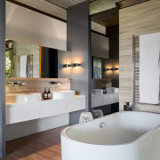 Travertine-look tiles on the floor of this renovated bathroom, interior design, room, gray, black
