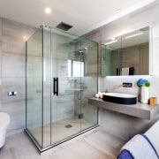 ​​​​​​​In this showhome by Chancellor Construction, the detailing bathroom, tile floor, home, black detail, shower enclosure, hansgrohe, Galaxy Tiles, Chancellor Construction