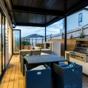 ​​​​​​​An outdoor Rinnai fire and barbecue feature on house, outdoor,  Rinnai Fire,  Barbecue,  Chancellor Construction, deck, pergola