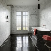 ​​​​​​​A black marble floor and white marble walls architecture, bathroom, floor, flooring, interior design, room, tile, wall, gray, tribal chair