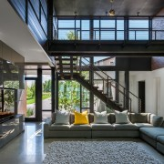​​​​​​​The living area in this family home is home, house, interior design, living room, furniture, light, industrial, Altus Architecture